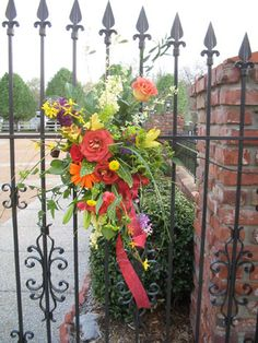 Floral Garden gate decoration for a wedding or special event.     Love the colors!                                                 Making Arrangements Florist | Wedding and special event florist in Nashville, Tennessee