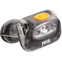 Not the ultra-light option, but I still love this headlamp. I have quite a few of the Petzl headlamps (for various members of the family), but this one remains my favorite. I use the red-light quite a lot when just needing to orientate myself around the campfire or entering the tent without disturbing others. The zippy thing is sometimes annoying when you wear it, but I like that it keeps it compact when not worn.