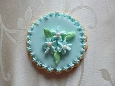 Hand-painted flower medallion sugar cookie in Blue