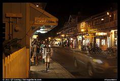 Tourists strolling store-lined street at night. Lahaina, Maui, Hawaii, USA