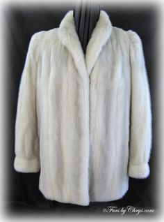 Azurene Mink Jacket #AM751; $1500.00; Excellent Condition; Size range: 4 - 8 Petite. This is a gorgeous genuine natural azurene mink fur jacket. It has a Nordstrom label and features a small wing-style collar, banded bracelet cuffs and lightly padded shoulders.  This azurene mink jacket is the perfect addition to take your wardrobe up a notch. You will look and feel like a celebrity in this luxurious fur jacket!