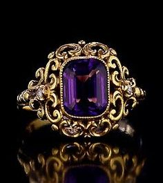 An Antique Russian Renaissance-style openwork gold ring with a Siberian amethyst by a prominent St. Petersburg jeweler Yakov Rosen, made between 1904 and 1908.