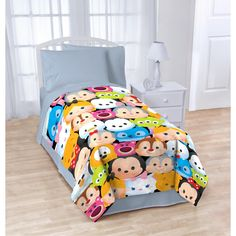Keep your child's bedroom cozy with this Disney Tsum Tsum Stack 'Em Up plush blanket. This blanket features a colorful pattern of Disney's Tsum Tsum characters to add a cheerful splash of color to a s