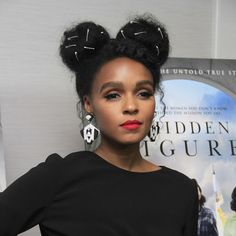 Janelle Monae is slaying this natural hair style with two buns and hair accessories. Click above for more celebrities with beautiful natural hair.