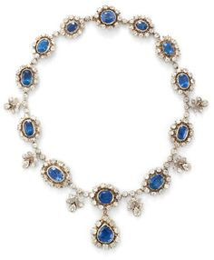 A sapphire and diamond necklace, earring and ring suite
