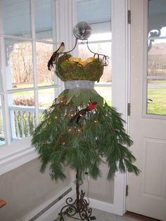Fashionista Christmas Tree. This was my Christmas Tree last year. I used a wire dress form, pine boughs, reindeer moss and a small string of lights. Isn't she pretty?