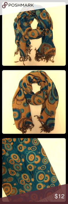 Teal and tan reversible pashmina scarf Beautiful real and tan reversible pashmina scarf. It's really nice and big and can also be worn as a wrap. In excellent used condition. Tassel ends. Super soft and comfortable. Accessories Scarves & Wraps
