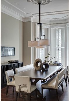 warm gray walls and dark wood. love the mouldings