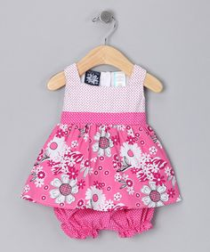 Product Description:  For your next work picnic, bring that stellar fruit salad and this bitty dress along with your little lady. A unique cut with intricate details will bring a smile to everyone's face. Full of verve and a combo of prints, this dress with matching bloomers will get way more compliments than your salad—which will be happy to take second to such a well-dressed darling.