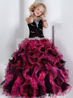 Spectacular Tiffany Princess Pageant Dress 13320. This organza and lame two tone pageant gown features sweetheart neckline, tank straps, and gorgeous sequins on the bodice and around the waist. A ruffled ball gown skirt completes the look of this pageant dress. This dress is sure to be a national level winning pageant dress. Available in Black/Fuchsia and Black/Turquoise.