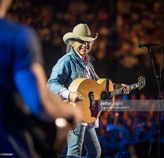 Dwight Yoakam performs onstage at the ACM Presents: Superstar Duets at Globe Life Park in Arlington on April 17, 2015 in Arlington, Texas.