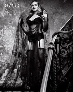 Photographed in black and white, Madonna poses in Gucci cape with La Perla bodice