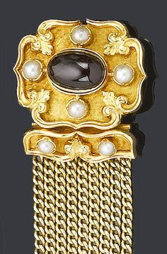 A 19th century gold, garnet and half-pearl bracelet The textured quatrefoil clasp, circa 1840, set with a central cabochon garnet and four half-pearls within a raised polished scroll border with fleur-de-lys detail, to a later nine-row trace-link bracelet with gold and half-pearl terminals, garnet is a later replacement, length 17.6cm., fitted case