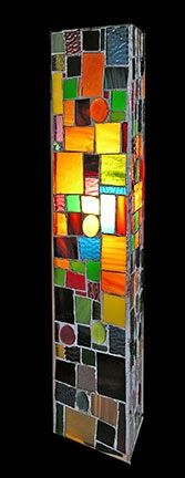 This is an odd sort of lamp. I made a three sided stained glass tower (about 24 inches high) and then put a small standing lamp inside. I co...