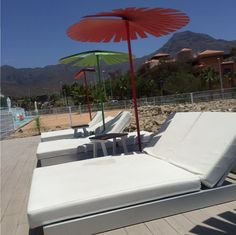Laying by the pool with our Colourful sun umbrellas