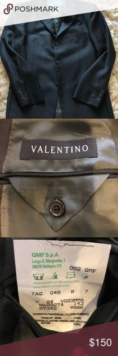 Men's Valentino Blazer Men's three button Valentino blazer. Double vent, interior pockets, navy and black small check (see last photo for good shot of check). It says it's a 48 regular, but is mis-marked. It is likely a 40 regular. My husband is normally at 38 short and it is just slightly to big in the shoulders and too long on him.  Very good used condition. Valentino Suits & Blazers Sport Coats & Blazers