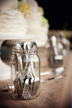 Mason Jar For Silverware At Wedding, maybe decorated with wedding colors...with all the silverware our families have, this could be a cute cost saver and give it a little bit of class...each table could have different sets of plates that belong to us