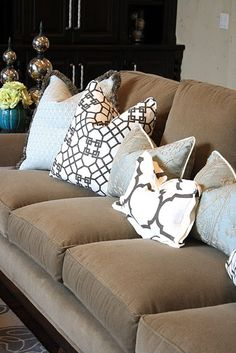 Great example of mixing patterns on throw pillows