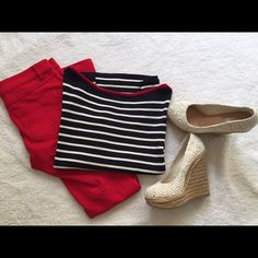 Ralph Lauren striped top Adorable navy blue striped half sleeve top with a red trim. Great with red pants, jeans, or a pair of white shorts! New with tags. Ralph Lauren Tops