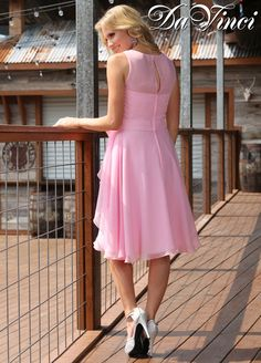 Looking for a sweet, feminine, and demure look  ideal for a spring or summer wedding? Style 60202 might be The One for your 'maids. One of our most romantic bridesmaid dresses, this pretty frock is made of light and airy chiffon and features an illusion neckline, peekaboo back, and full A line skirt all wrapped up with a chiffon sash. Shown here in pink, you or your girls can order this dress for your wedding in one of over 50 gorgeous shades to match your color palette.