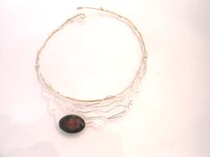 gold and silver necklace with a beautiful agate embellishment