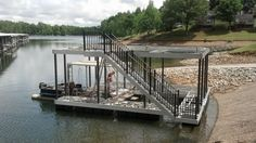 Wahoo Docks dealer Dennis English and DockScapes is installing a nice CAT 3 single-slip floating aluminum lake dock at Tim's Ford for a client in Fayetteville, Tenn. The wide side dock is covered in Timber Tech XLM Sandstone decking. It also has mainframe bumpers to protect the exterior of the owner's boat from scratches. The upper patio also has Wahoo Docks proprietary sandstone AridDek aluminum decking with upgraded railing around the circumference. Railing and roof poles are antique…