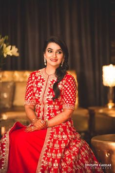 We cannot stop swooning over our bride's bright red jacket lehenga with detailed gotta patti word. WOW!