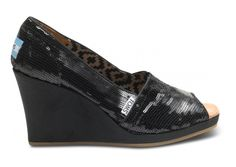 TOMS black sequin wedges. I'm usually not one for much sparkle, but these I like.