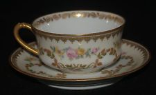 HAVILAND PORCELAIN LIMOGES GOLD GILT ROSE SWAG CUP AND SAUCER YELLOW RED BLUE