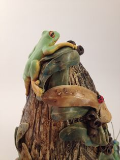 "Detail shot of ""Creature Comforts"" by Tanya Bechara Hop'n Frog Pottery   (Features frog, grasshopper, skink lizard, caterpillar & ladybirds)"