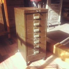 Green metal file cabinet on castors- The General Store