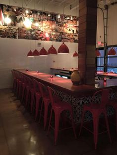 The restaurant features lots of red and white. | Courtesy of Mercato Italiano