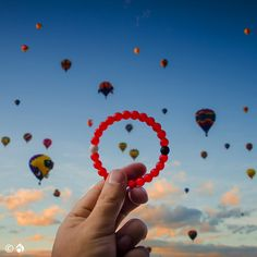 The highest and lowest points on Earth are brought together within the beads of the Lokai Bracelet as a reminder to stay positive during the highs and lows of life.