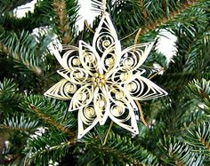 Quilled Poinsettia Ornament - DIY by all things paper, via Flickr
