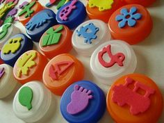 Bottle caps with foam stickers to make stamps.... What an idea