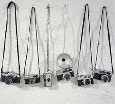 i like all of the old cameras in this picture and they are displayed i a neat way #semiphoto