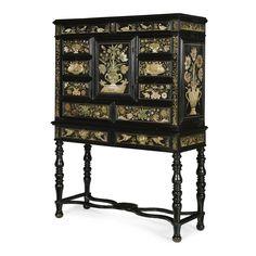 A scagliola mounted ebony veneered and ebonised cabinet, the scagliola panels attributed to Baldassare Artima, Charles II, circa 1670.