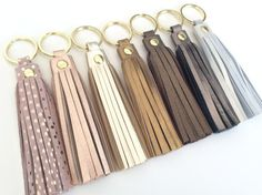 This beautiful leather tassel keychain is a stylish way of organising your keys.  If you cant find the color you like i can always make something else for you. Ladies attach it to your keys so you can find them more easily in your bag.... Believe me i know :))) But also you can use it as a purse charm to give your bag a more fun or boho look. Or simply attach a chain to it transforming it to a tassel necklace The lenght of the keyring (including the split ring) is 14cm or 5.5 inches.  Split…