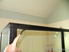 you buy a house and can't afford upgrades: Change out your builder grade brass shower trim using Rustoleum's Oil Rubbed Bronze spray paint ... what would cost you $800 to replace, will only cost you $5 to paint. Holds up well with the water because it is indoor/outdoor paint..... (Pinner says: I also did this with my light fixtures when we moved into our house)