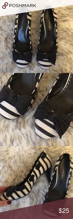 Beautiful striped black and white Gianni Bono's These are so cute and in great condition. They have only been worn a couple times and are super comfortable. Tiny bit of wear which reflects price but still so pretty. Gianni Bini Shoes Heels