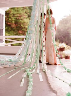 Paper chain garlands in alternating shades of white and mint add instant DIY panache to a simple porch ceremony.  But great idea for party decoration too!