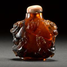 amber snuff bottle with carved decoration  1889-1940
