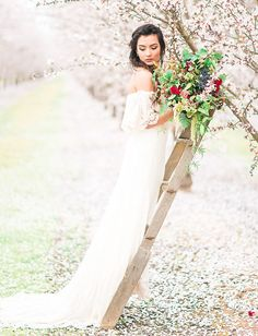 Daughters of Simone wedding dress in a dreamy almond orchard setting