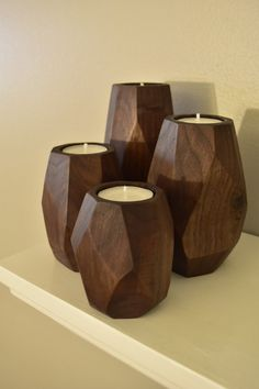 4 Faceted walnut tea light candle holders 3 tall 4 tall 5 tall and 6 tall solid black walnut finished with all natural beeswax. Small Wood Projects, Diy Furniture Projects, Woodworking Projects, Modern Candle Holders, Wood Candle Holders, Wooden Art, Wooden Crafts, Craft Room Lighting, Craft Table Ikea