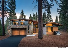 Front View Of The Modern Contry House With Stones And Woods Facade Also Curved Roof Design Along With Wooden Garage Door And Pavement Way Surrounded With Pine Woods Modern country house with a curved roof in California Home design Dream House Exterior, Dream House Plans, Roof Design, Exterior Design, Quonset Hut Homes, Contemporary Cabin, Wood Garage Doors, Mountain Homes, House Roof