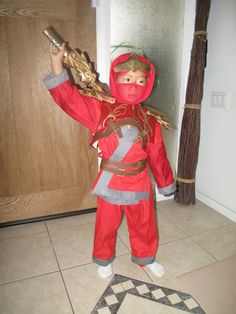 Ninjago Kai -- very detailed costume -- photo tutorial on how he made it.  Too involved for me (carving foam for headpiece, shoulder plates, & dragon sword!)