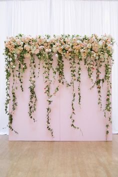 This pink flower feature wall will have you feeling like a storybook princess on your wedding day.