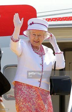 Queen Elizabeth II and Prince Philip, Duke of Edinburgh (not pictured) wave…