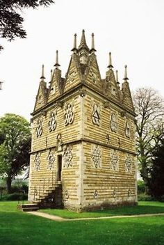 The Triangular Lodge:    A folly, designed and constructed between 1593 and 1597 by Sir Thomas Tresham near Rushton, Northamptonshire, England. Tresham was a Roman Catholic and was imprisoned for a total of fifteen years in the late 16th century for refusing to become a Protestant. On his release in 1593, he designed the Lodge as a protestation of his faith. His belief in the Holy Trinity is represented everywhere in the Lodge by the number three: it has three walls 33 feet long, each with…
