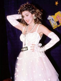 "September 14, 1984: Madonna looked both naughty and nice when she hit the stage of the inaugural MTV Video Music Awards for her debut performance of ""Like a Virgin."" The lacy wedding dress and infamous ""Boy Toy"" belt turned heads around the world and remains one of her most iconic looks."